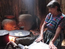 Mayan woman making tortillas during a school trip