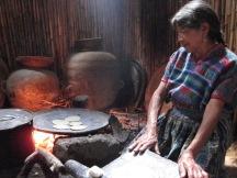 Mayan woman making tortillas during a school trip