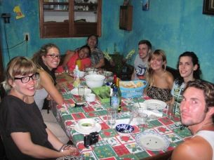 Eva, her daughter, and students around the dinner table